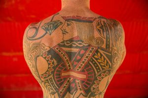 Portrait of a King of Hearts Tattoo on the Back of a Shirtless Man
