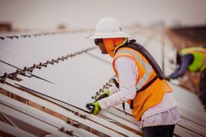Man Installing a Solar Panel
