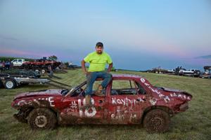 Man Sitting on His Car at a Demolition Derby
