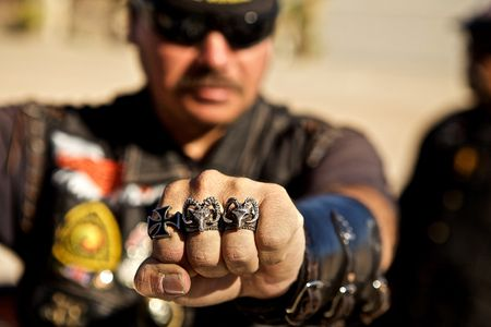 Man Showing his Fist of Rings