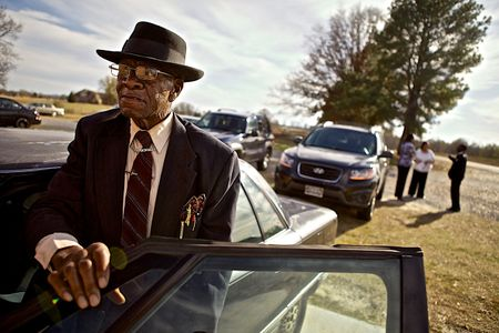 Man Getting Into a Car After Church