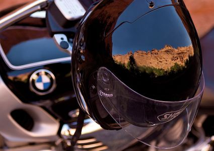 Reflection of a Landscape On a Motorcycle Helmet