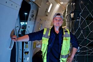 Load Master of a 747 Cargo Transportation Plane