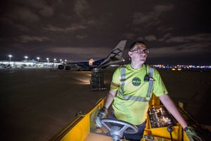 Airport Cargo Worker Driving a Lift