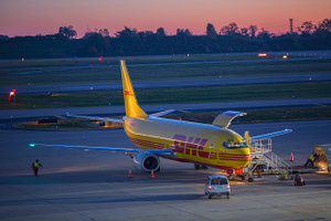 DHL Plane Being Off loaded at Sunrise