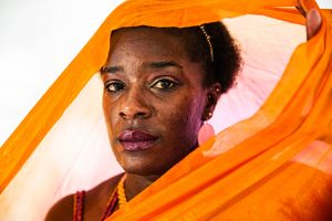 Portrait of a Woman With Orange Scarf