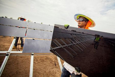 Worker Holding a Solar Panel).jpg
