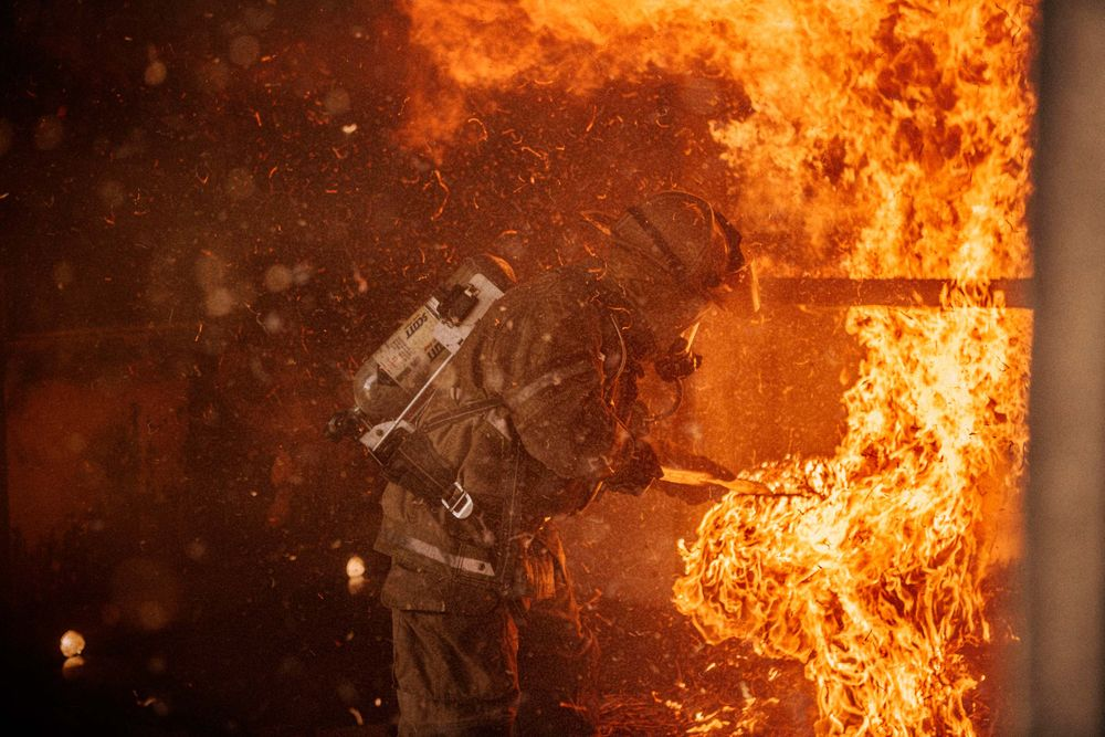 Fireman Putting Out Fire Surrounded By Flames