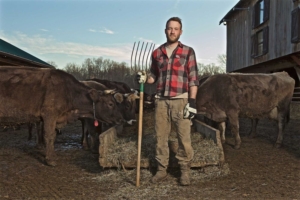 Farmer Standing Holding a Pitch Fork
