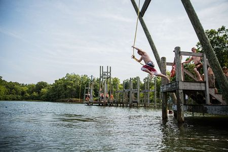 Photo of Bay Scout Jumping off a Dock