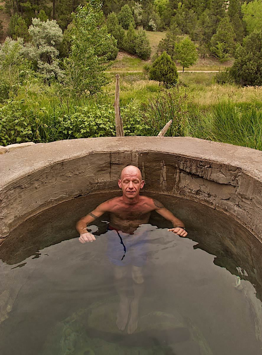 Man Relaxing In Natural Hot Spring