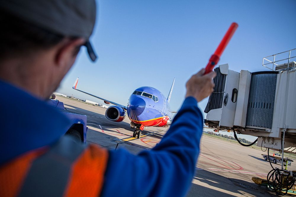 Aircraft Marshaling A Southwest Plane To the Gate