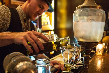 Bartender With a Fountain Pouring Absinthe