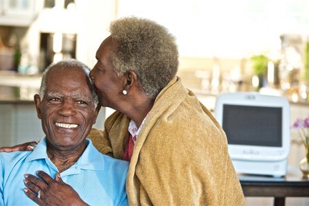 Senior citizen Couple Kissing and Smiling