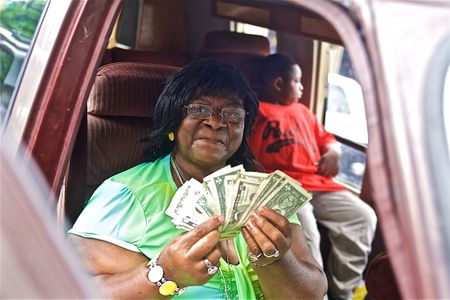 Wife of T Model Ford Holding Dollars