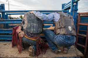 Bull Riders Praying Before a Bull Riding Competition