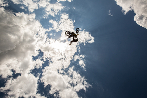 Motorcycle Performing a Stunt Sky High