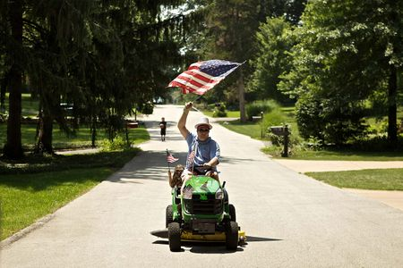 Man with American Flag on a Tractor