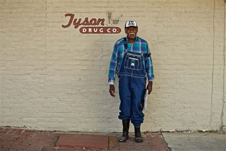 Man in front of Tyson Drug Co.