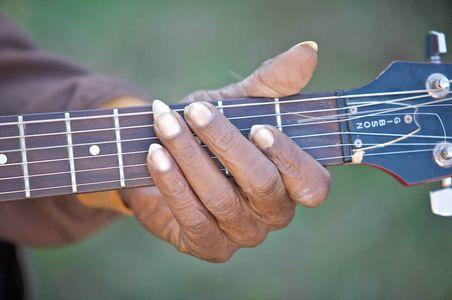 RL Boyce Hand on a Neck of a Guitar