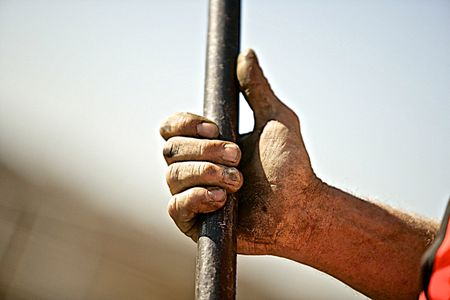 Workers Hand Holding a Bar