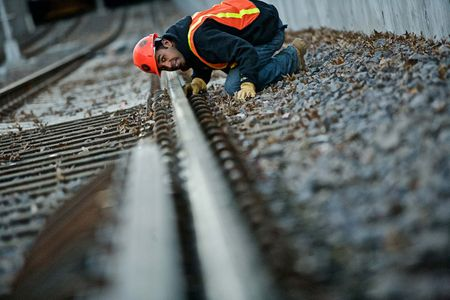 Man Inspecting a Railroad