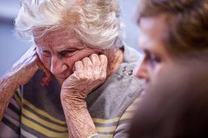 Elderly Woman With Head In Her Hands