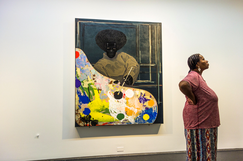 black woman with painting (small).jpg