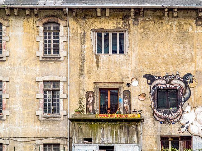 Apartment building with dog mouth. Paris