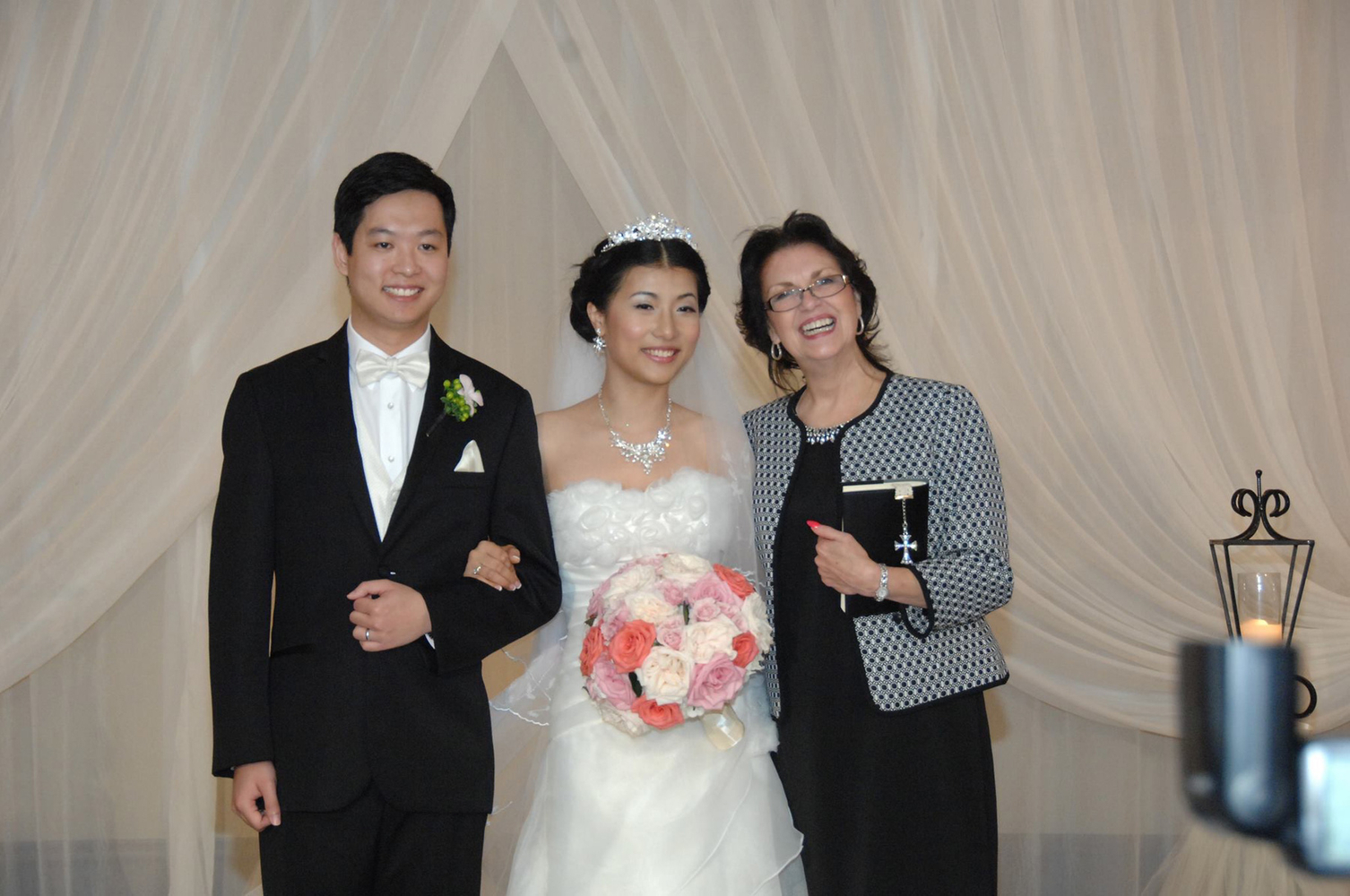 Indoor wedding of asian couple at the Houston Hilton with Minister Lynn Turner of Weddings Performed.