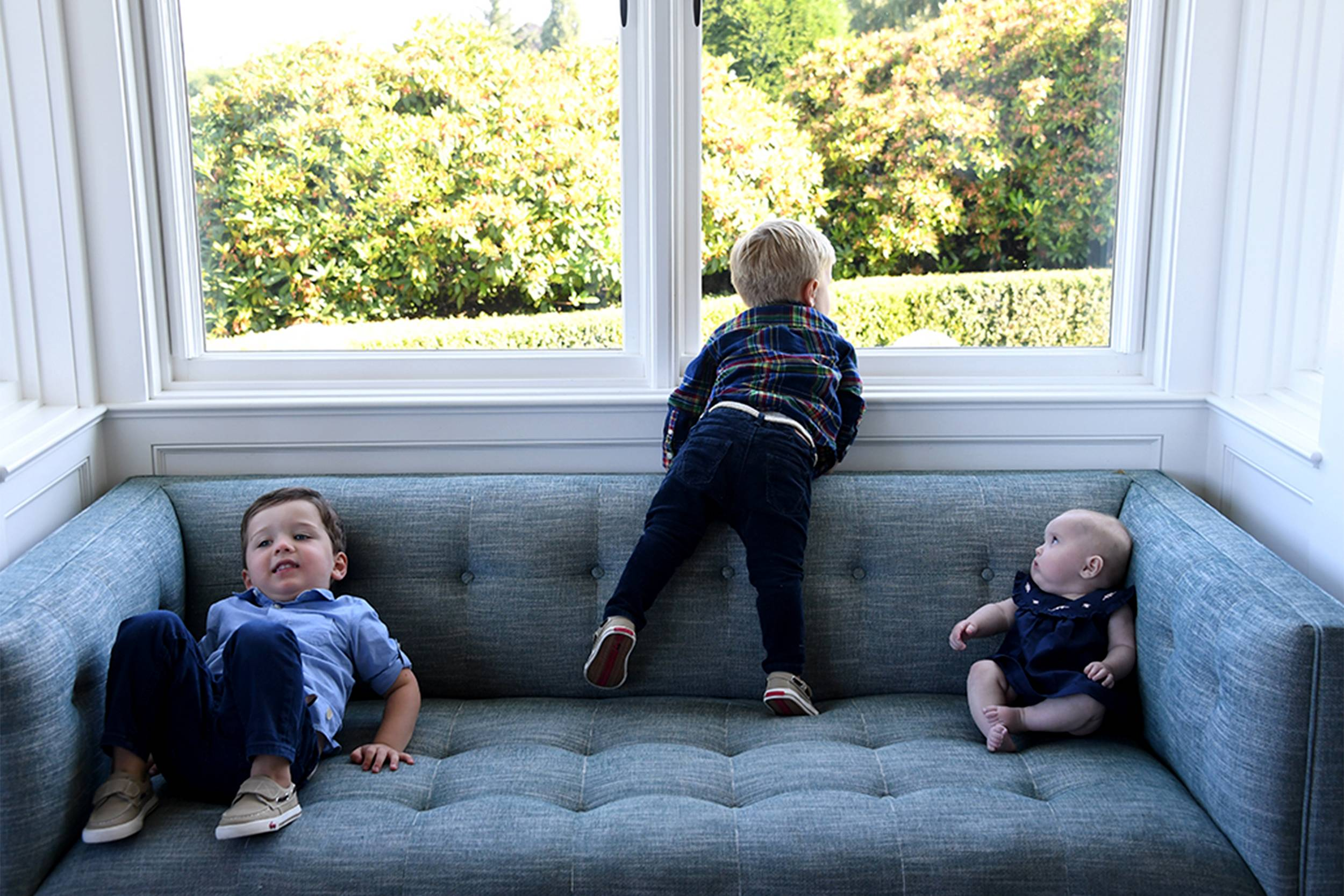 Pohlad children on couch for website.jpg