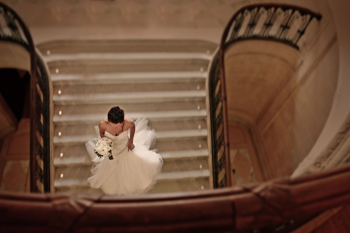 Bride on the staircase at the Armour House at Lake Forest Academy