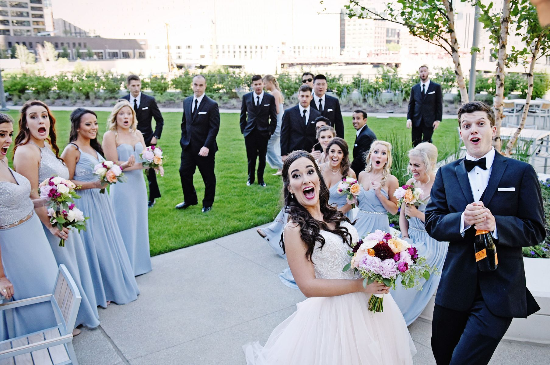 Wedding-Bridal-party-pops-Champagne-at-photographer-and-hits-camera-by-accident.jpg