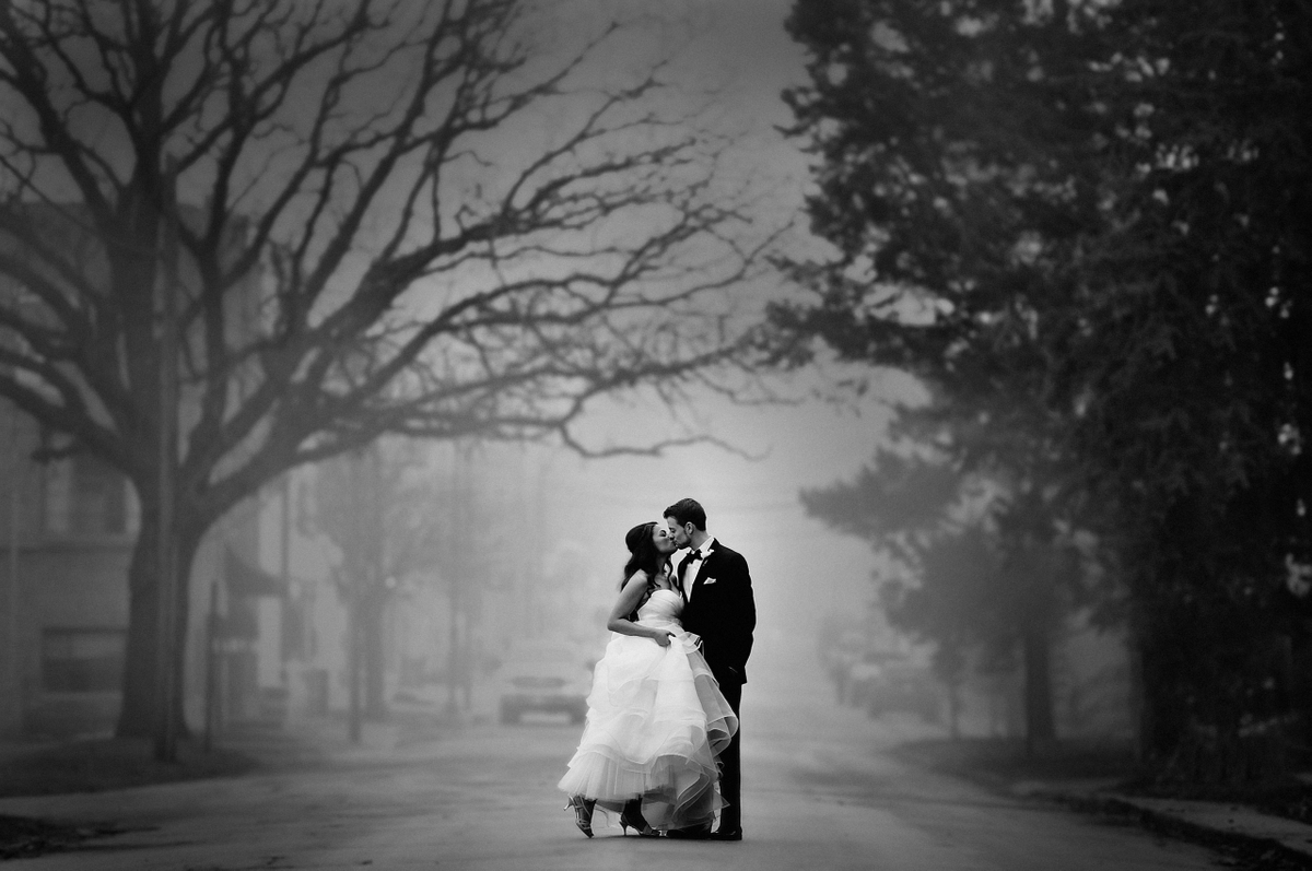 Wedding photo kiss by the Starline Factory Harvard IL