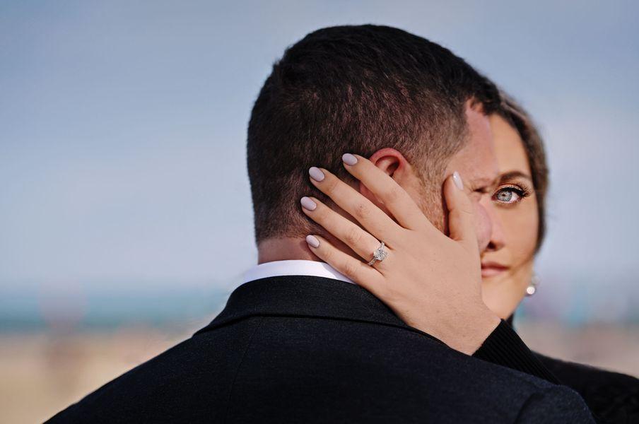Engagement photos by Lake Michigan in Chicago