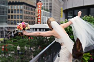 Bride on the balcony at Renaissance Chicago Downtown Hotel