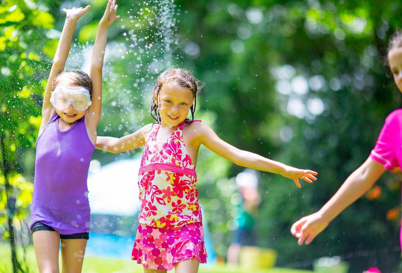 Girls in sprinkler