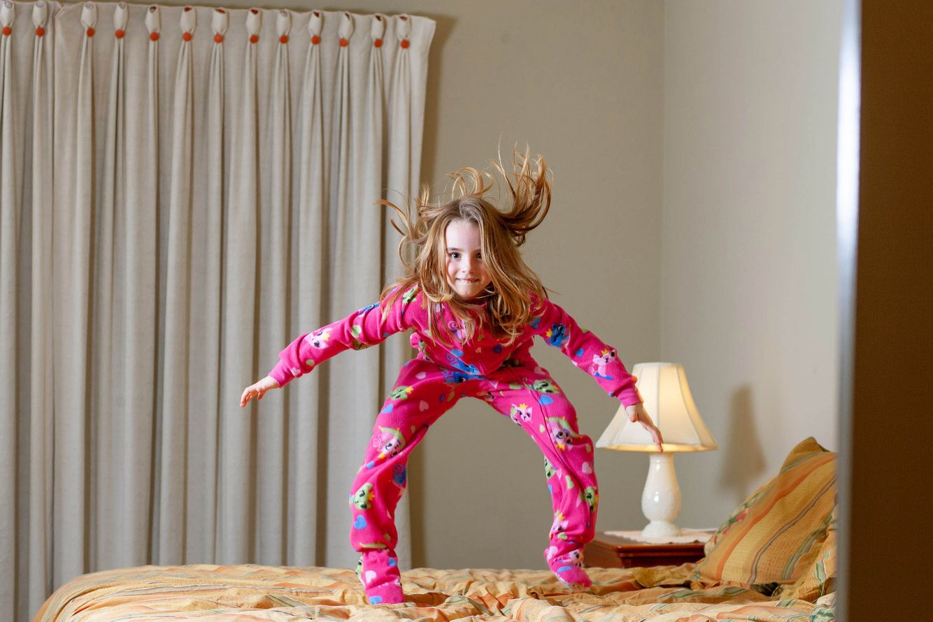 First born jumping on bed