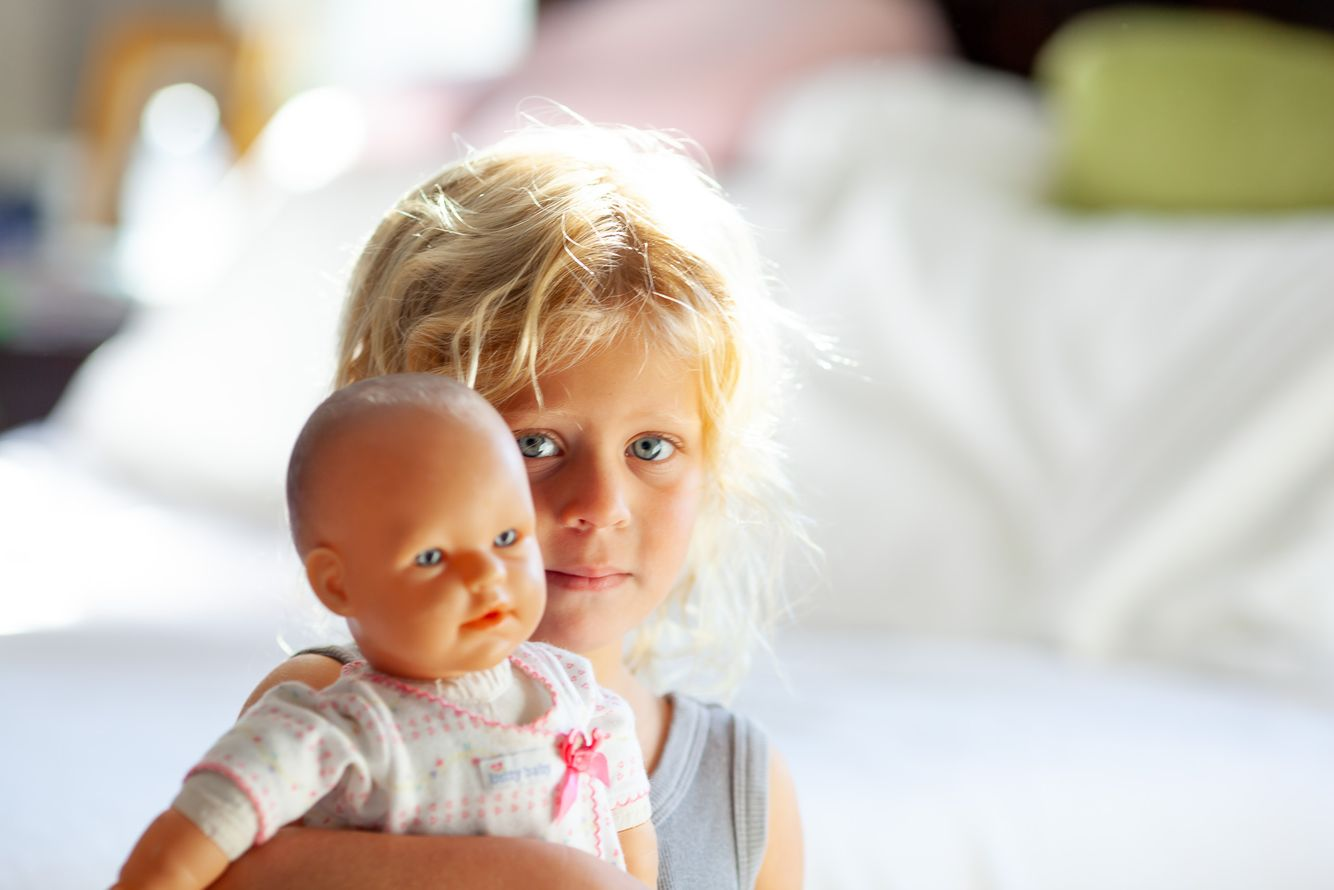 Toddler with doll