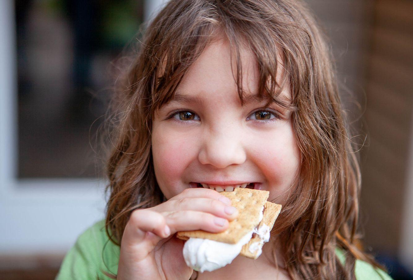 Daughter eating smores
