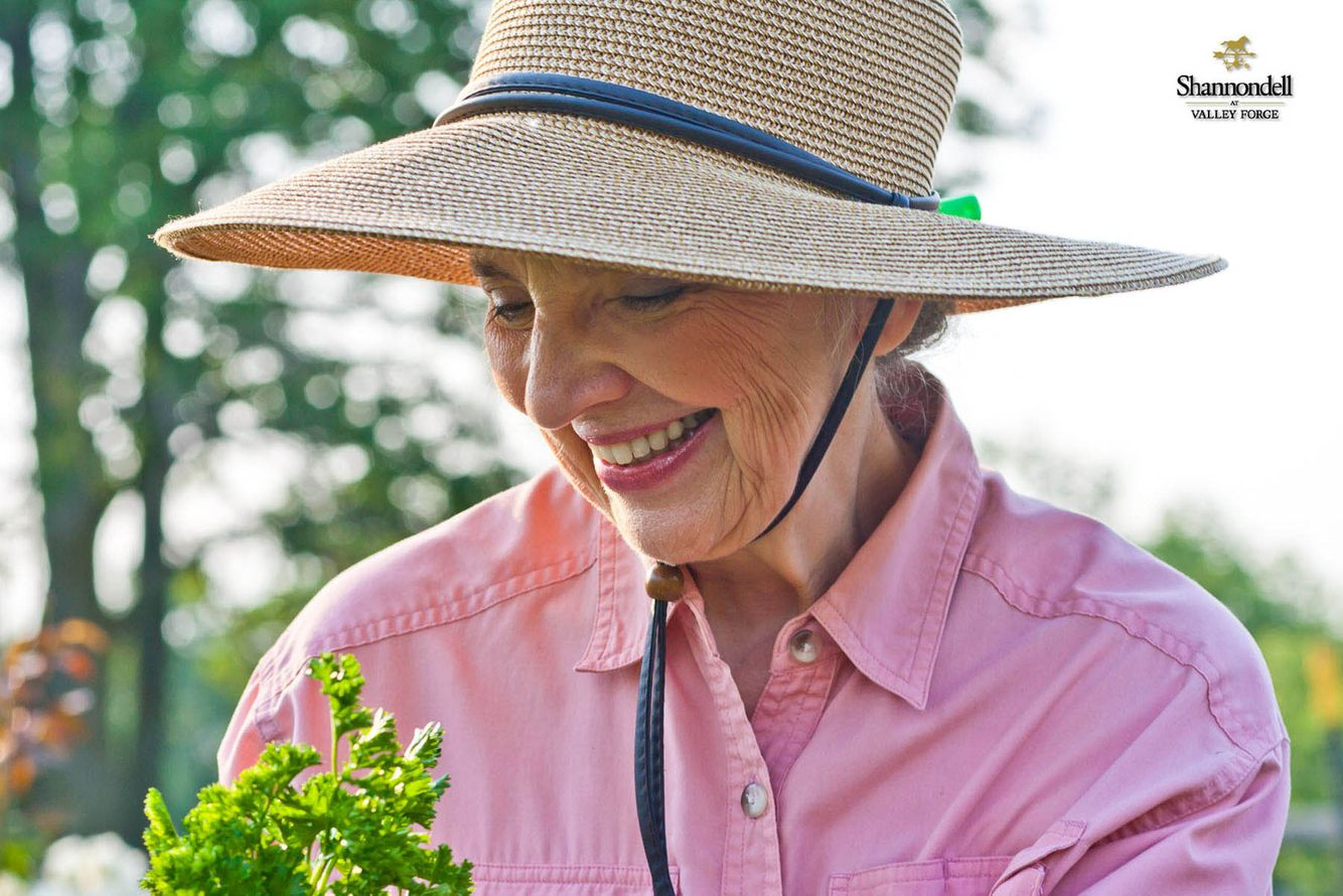 older woman with herbs