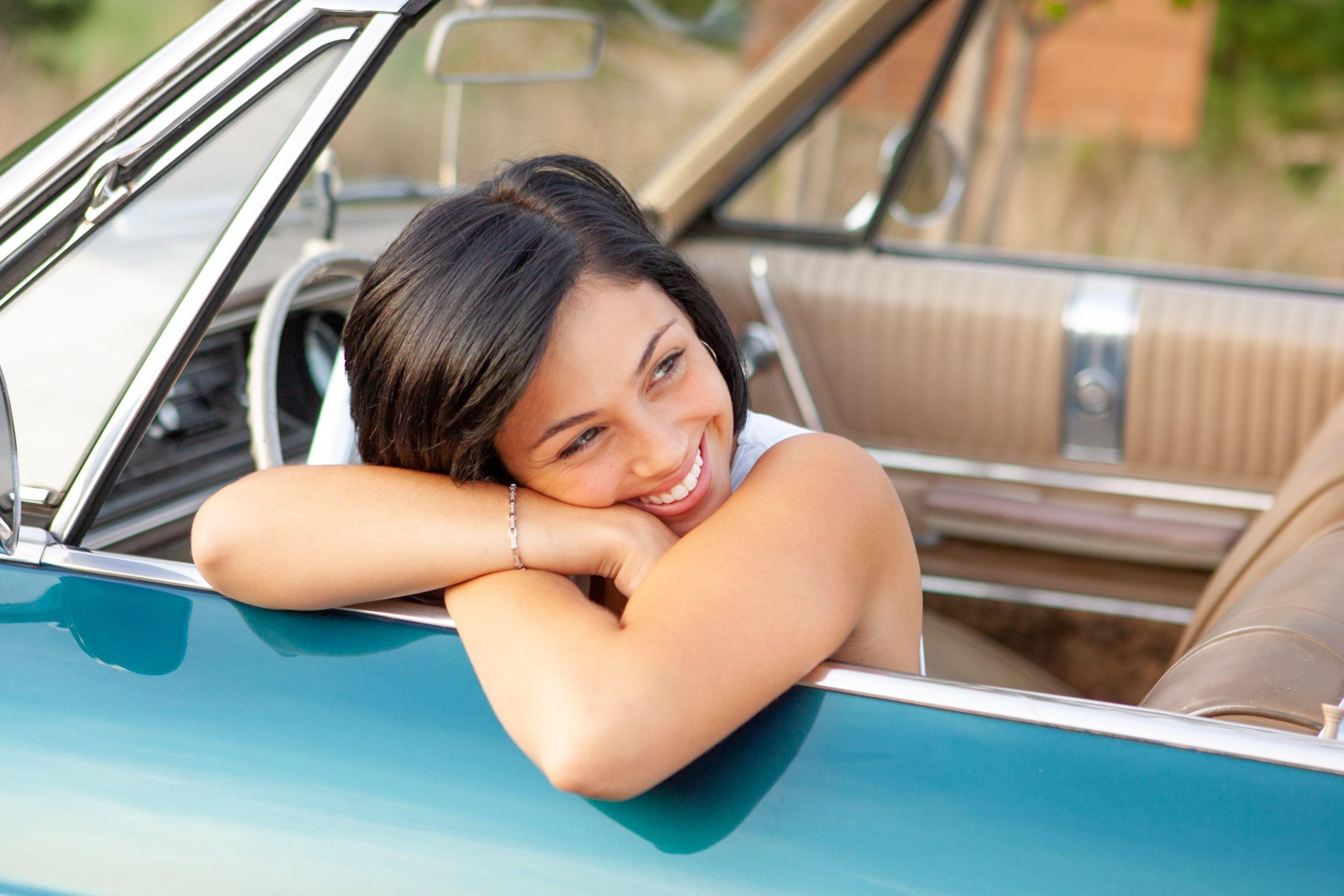 pretty woman in car