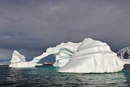 Ice-berg-with-arch-and-MV-Ortelius_S6A9198-Booth-Island-Antarctica.jpg
