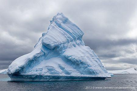 Ice-berg-floating-against-dramatic-sky_B8R6841-Lemaire-Channel-Gerlache-Strait-Antarctica.jpg
