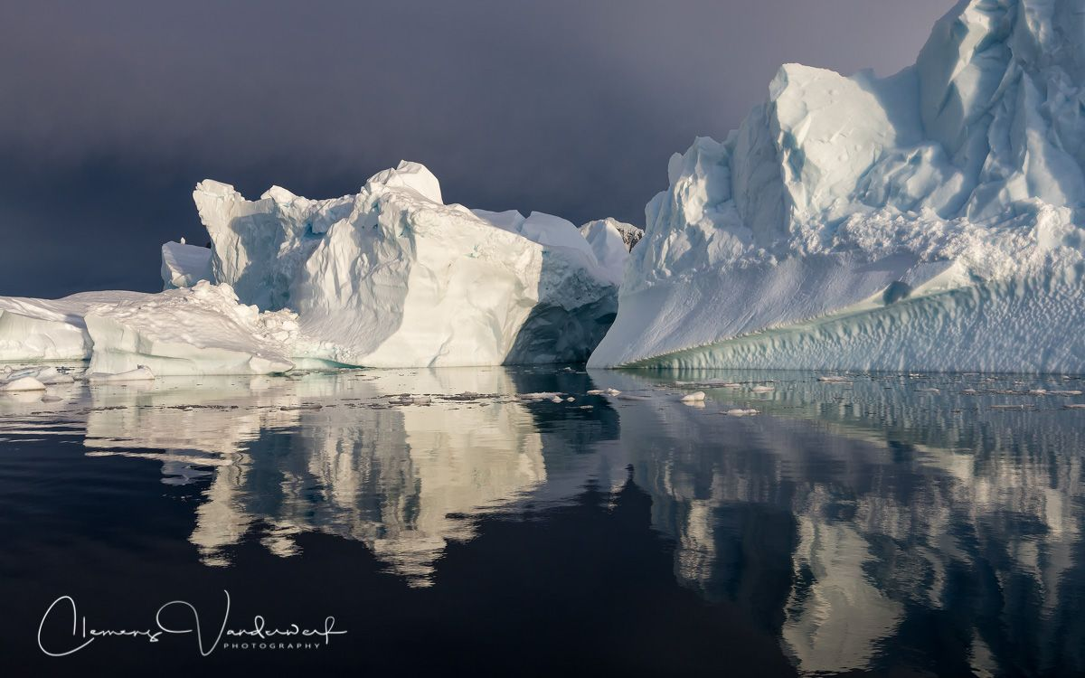 ice-berg-with-dark-sky-and-last-sunlight_s6a9219-booth-island-antarctica.jpg