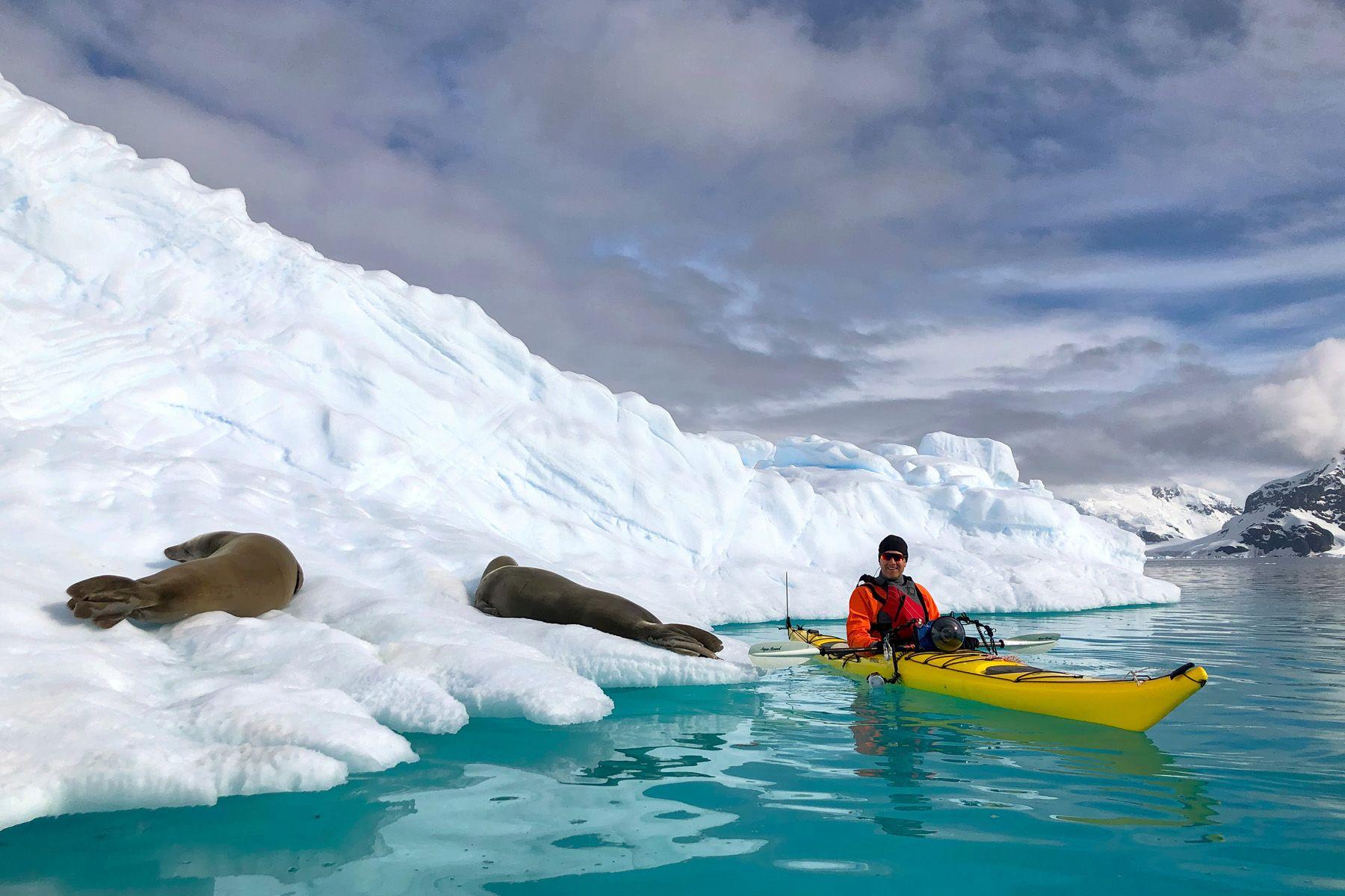 Clemens in kayak with seals on iceberg_1800_IMG_1862_Paradise Harbour, Antarctica.jpg