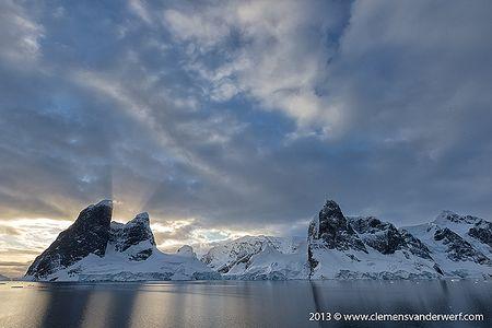 Morning-sun-hiding-behind-mountain-peaks_B8R6679-Lemaire-Channel-Gerlache-Strait-Antarctica.jpg