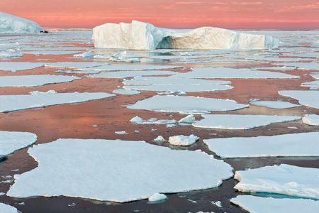 Iceberg-and-sea-ice-with-pink-sky-and-water_S6A9023-Graham-Coast,-Antarctica.JPG