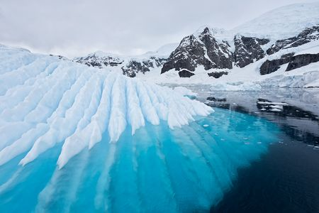 Iceberg-with-ripples-and-glacier-background_S6A9595-Paradise-Bay-Antarctica.jpg