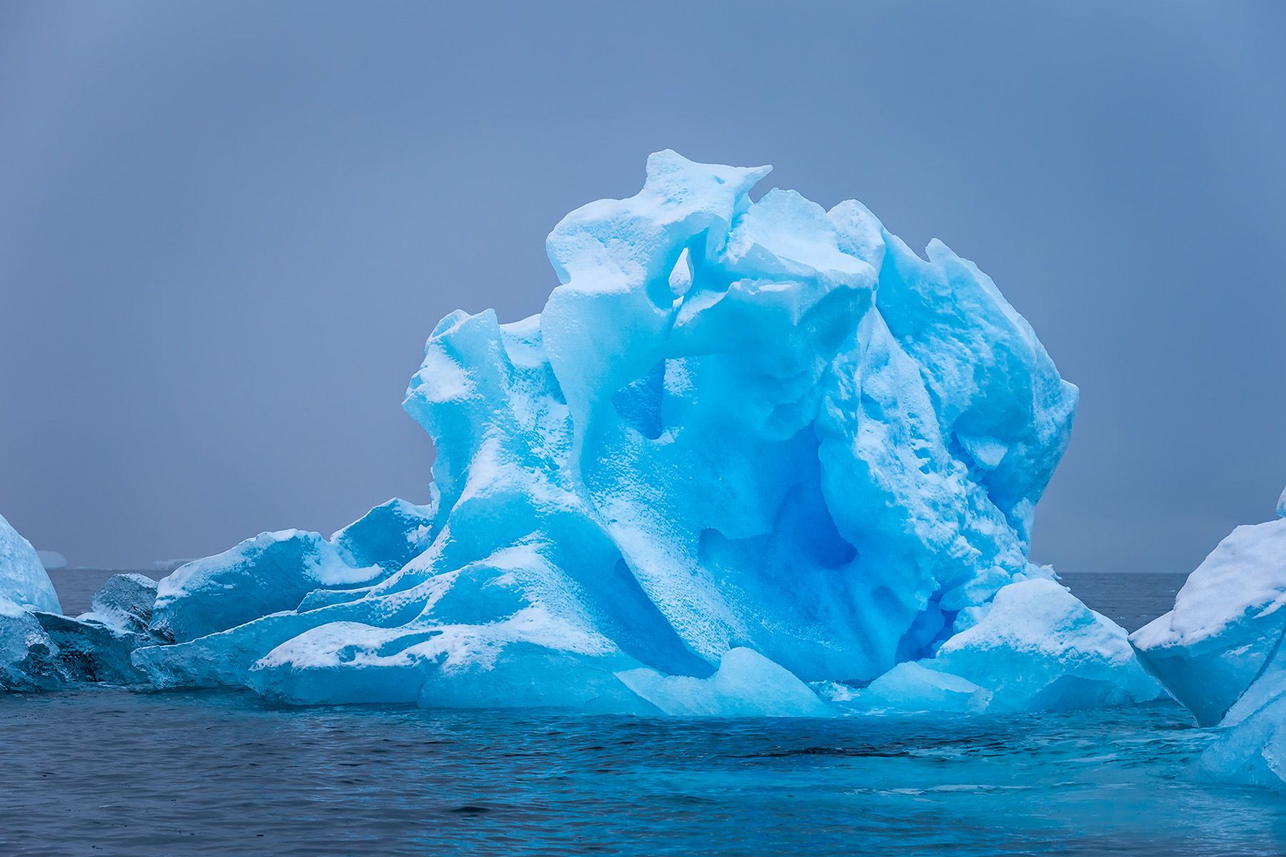 Blue ice with snow cover_B8R6476-Cierva Cove, Hughes Bay, Antarctica.jpg